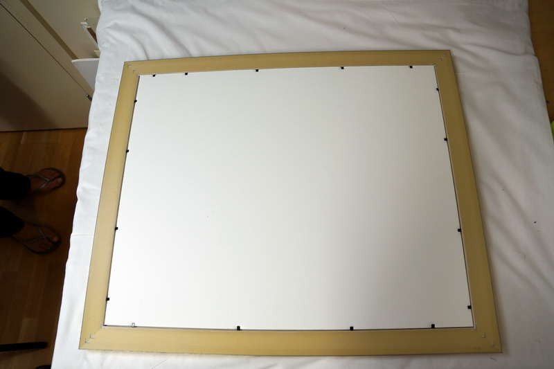 acid free mat and backing boards held in place with flexible points